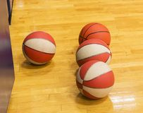 Basketballs on gym floor royalty free stock images