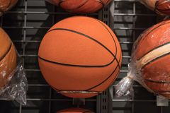 Basketballs on the rack of sports retail store. Ready for sale royalty free stock photography