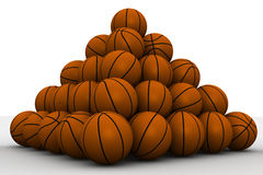 Basketballs stacked pyramid Royalty Free Stock Photography
