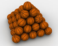 Basketballs stacked pyramid Royalty Free Stock Photo