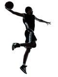 Basketbalspeler één handslag dompelt silhouet onder Royalty-vrije Stock Afbeeldingen