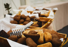 Basketful of ciabatta bread on a buffet table Royalty Free Stock Photography