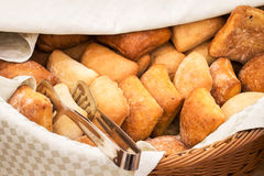 Basketful of ciabatta bread with tongs Royalty Free Stock Image