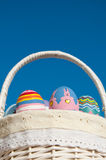 Basketful of colorful hand painted Easter eggs Stock Images