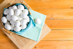 Basketful of fresh white eggs with one outside stock photography