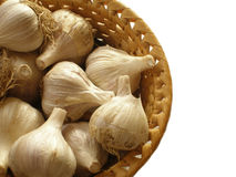 Basketful of garlic. Isolated against white background royalty free stock images
