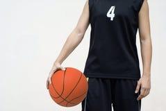 basketkvinnligspelare arkivfoto
