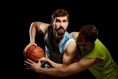 basketmän som leker två royaltyfria bilder