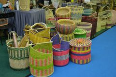 Basketry. Basket weaving is the process of weaving or sewing pliable materials into two- or three dimensional artifacts, such as mats or containers. Craftspeople royalty free stock image