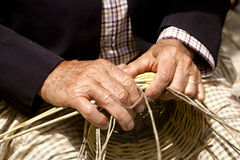 Basketry craftsman hands working Stock Photography
