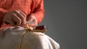 Basketry. View of boy cleans twig from bark. Close-up stock video footage