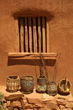 Baskets against an adobe wall. Royalty Free Stock Photo