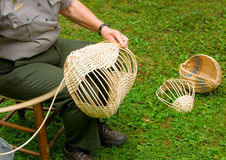 Baskets being made in the traditional way by settlers in the appalachians. An demonstration of weaving the old-fashioned way as seen at mabry mill, virginia Stock Photos