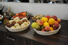 Baskets of bread and fruits on buffet table at the hotel Stock Image
