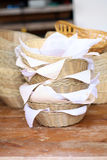 Baskets of bread on a wooden table Royalty Free Stock Images