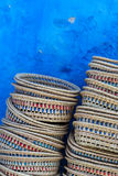 Baskets in chefchaouen. Pile of baskets on market in blue town of chefchaouen, morocco royalty free stock images
