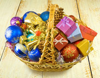 Baskets with Christmas decorations on a table Royalty Free Stock Image
