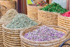 Baskets of colorful natural organic herbal tea in Marrakech market, Morocco. group of beautiful dry colorful flowers. Dried roses royalty free stock image