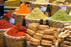 Baskets of Colorful Turkish Spices at the Grand Bazaar in Istanbul, Turkey. Baskets full of colorful spices, cinnamon and ginger  at the Grand Bazaar marketplace Royalty Free Stock Photos