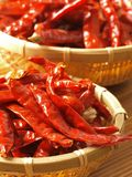 Baskets of dried chilies. Close u of baskets of dried chilies Stock Photo