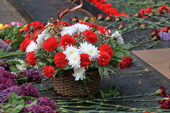 Baskets with flowers at the memorial Eternal Fire. Pyatigorsk, Russia. Pyatigorsk, Russia - May 9, 2017: Baskets with flowers at the memorial Eternal Fire on Stock Photos