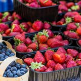Baskets Of Fresh Strawberries In A Street Market Stock Image