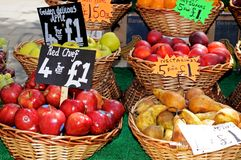 Baskets of fruit on market stall. Royalty Free Stock Images
