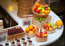 Baskets with fruits and berries standing on counter Royalty Free Stock Photo