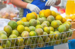Baskets full of beautiful oranges for sale at the farmer's marke Stock Image