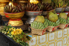 Baskets of green bananas and coconuts Stock Photo