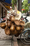 Baskets and hats overloading bicycle in Bangkok, Thailand. Street Sellers use their bicycles to sell their goods in Bangkok, Thailand. Sometimes the bicycles are Royalty Free Stock Photos