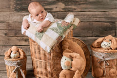 Baskets and infant. Baskets and cool infant. Cute little kid Royalty Free Stock Photography