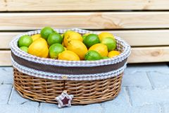 Baskets with lemons in outdoors market of Sorrento, Italy. Baskets with lemons on the open market of Sorrento, Italy. side view Royalty Free Stock Images