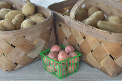 Potato Baskets. Baskets of new and russet potatoes for sale at a roadside fruit and vegetable stand royalty free stock image