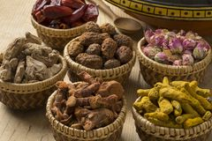 Baskets with North African dried herbs Stock Photo