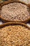 Baskets with nuts. Baskets full of dry fruits in exhibitor. We see pistachio nuts and peanuts - Cestas llenas de frutos secos en expositor. Vemos pistachos y Stock Images