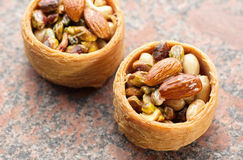 Baskets with nuts on the table Stock Photos