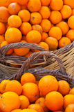 Baskets of oranges. Photograph of baskets of oranges taken on a market Royalty Free Stock Photography