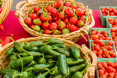 Baskets of peppers and tomatoes Royalty Free Stock Image