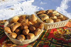 Baskets with pies. Round and square basket filled cakes are on the table in the winter on the street Stock Photo