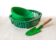 Baskets for planting bulbs. And garden shovel on a white table Stock Image