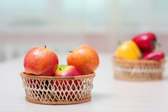 Baskets with ripe red apples Stock Images