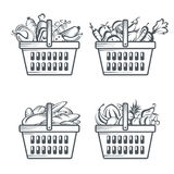 Baskets with sausages, fruit, vegetables and bakery Stock Images
