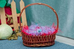 Baskets from the shoulders. candy in the basket. Beautiful Easter basket royalty free stock photography