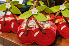 Baskets similar to cherries. Are made of cloth on the table Royalty Free Stock Images