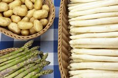 Baskets of sparrowgrass and potatoes Royalty Free Stock Photography