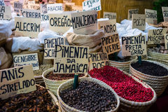 Baskets of spices at stall in street market stock photo