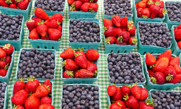Baskets of strawberries and blueberries Stock Image