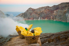 Baskets with sulphur at Kawah Ijen krater, Indonesia Royalty Free Stock Photo