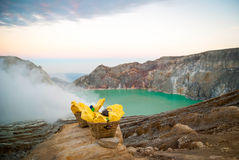 Baskets with sulphur at Kawah Ijen krater, Indonesia Royalty Free Stock Photography